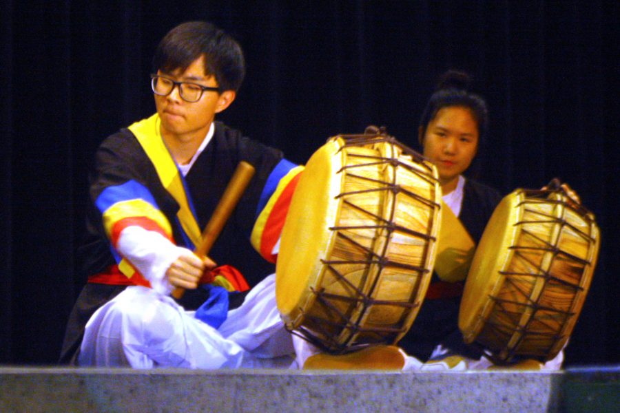 At+the+2016+Culture+Fair%2C+senior+Derek+Jang+and+junior+Sharon+Park+play+traditional+Korean+drums+with+the+group+called+Daool%2C+which+means+%22united+as+one%22+in+Korean.+In+preparation+for+the+performance%2C+the+group+practiced+two+hours+per+week.+In+addition+to+the+McNeil+culture+fair%2C+Daool+also+performed+at+Asian+events+throughout+Central+Texas.