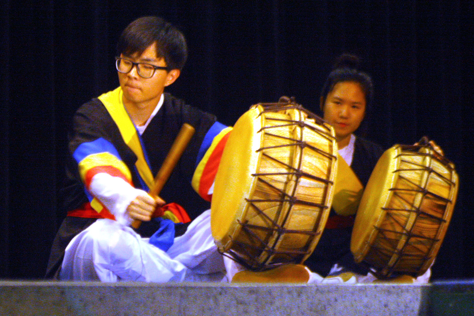 At the 2016 Culture Fair, senior Derek Jang and junior Sharon Park play traditional Korean drums with the group called Daool, which means