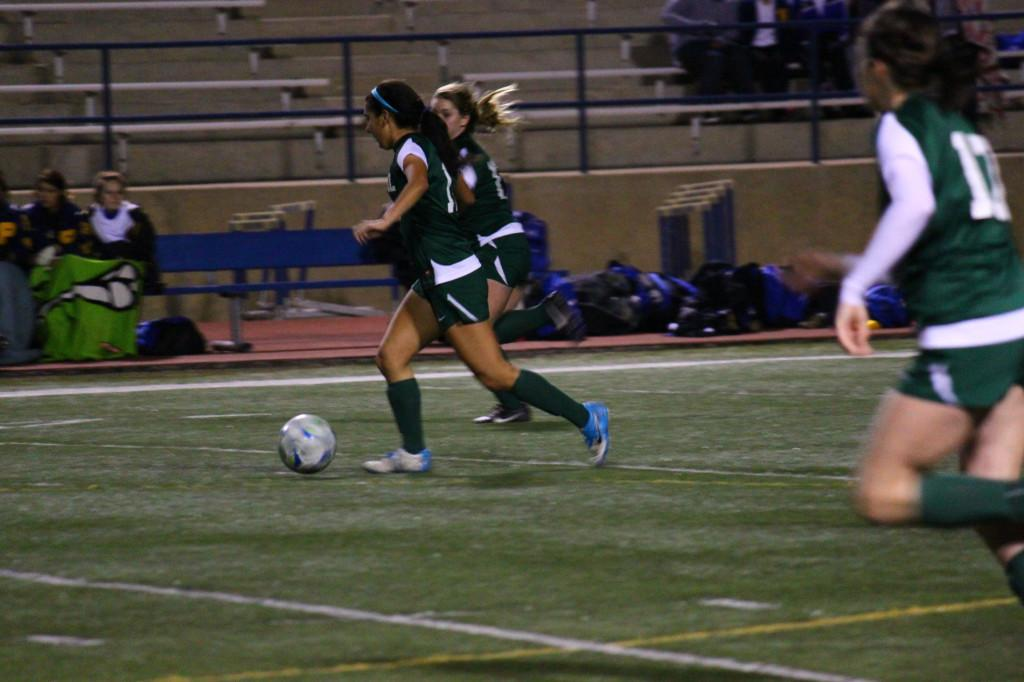 Varsity player Alex Ortiz dribbles the ball away from Pflugerville players.