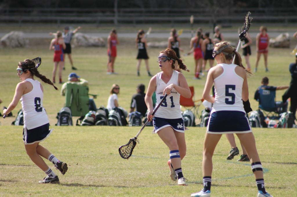 Senior Kailyn Elkins,  Senior Mallory Stone, and Sophomore Ellie Ojeda playing defense