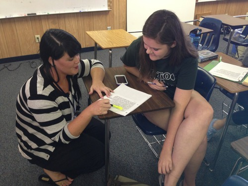 Latin teacher Keely Drummonds helps Kailyn Brush with her assignment.