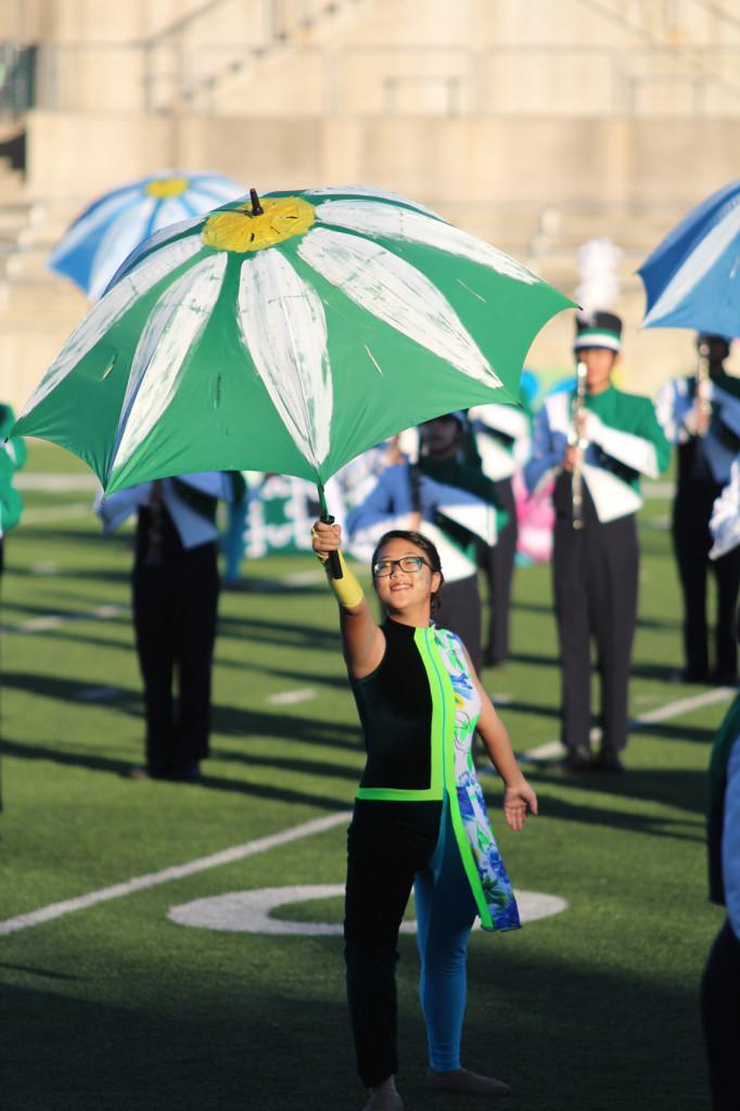 Members of the marching band and color guard, including Sami Kim (pictured), earned third place at the Texas Marching Classic competition.