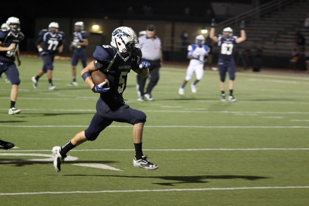 Colton Russell charges down the field for a touchdown.