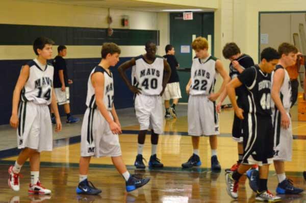 Boys' Basketball Takes a Loss Head On