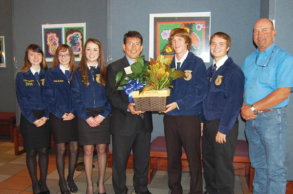 FFA members bring the new Superintendent, Dr. Steve Flores, a welcome gift.