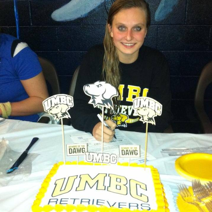 Kira Morgan officially signing her intent to swim for UMBC