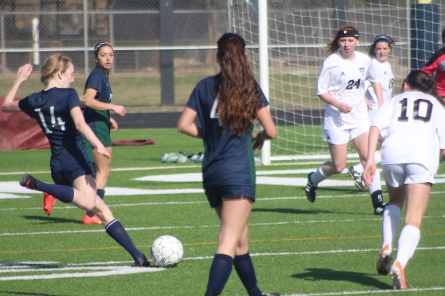 Lauren Denton (12) takes  a shot for a goal.
