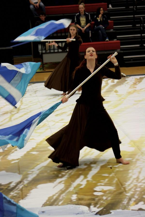 During a competition, Andie Mau performs the winter guard show Severus and Stone.