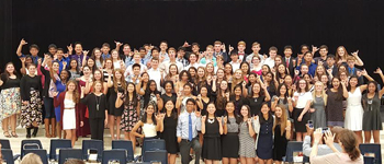 NHS inductees pose for a group photo after the ceremony