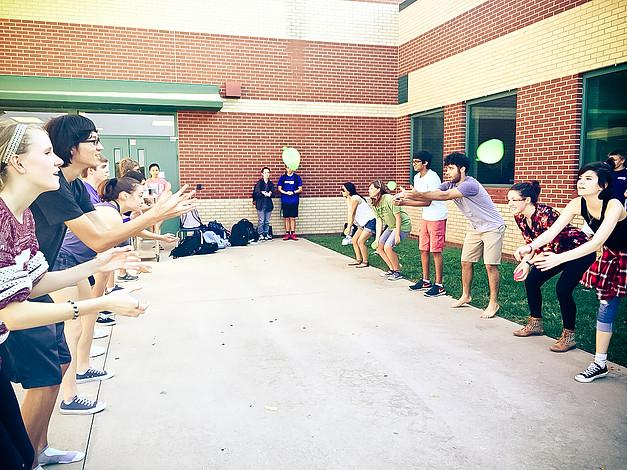 Latin Club members participate in an Olympic event-- water balloon toss.