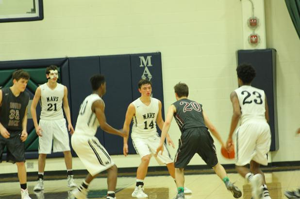 Varsity boys basketball finish season as district champs