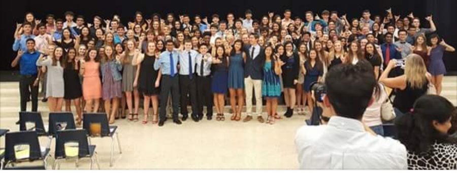 New members attend the induction ceremony, where the NHS officers officially announce the new members.