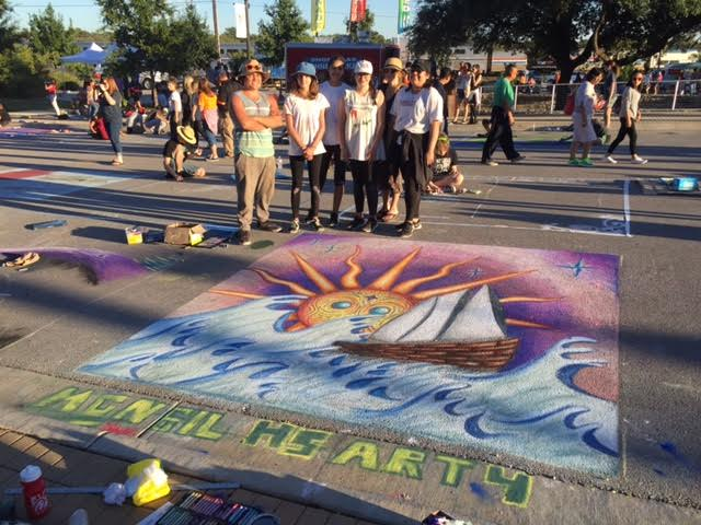The team of students with their finished piece at Round Rock Chalk Walk