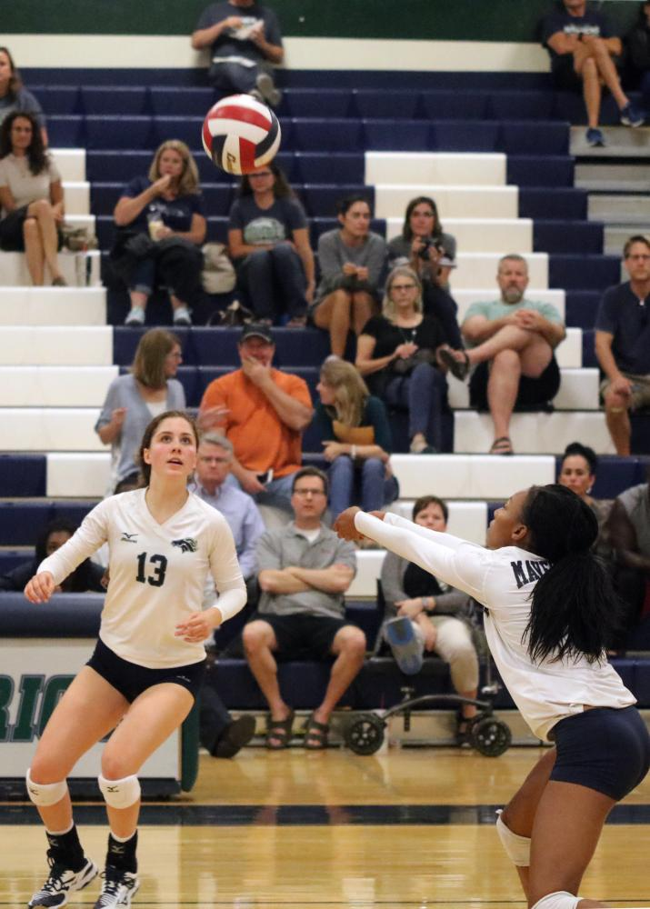 Aliyah Levert digs up ball that Emma Ramirez sets up