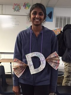 Junior Amrita Mayavaram poses with her letter, D. Her sin involves disobedience.