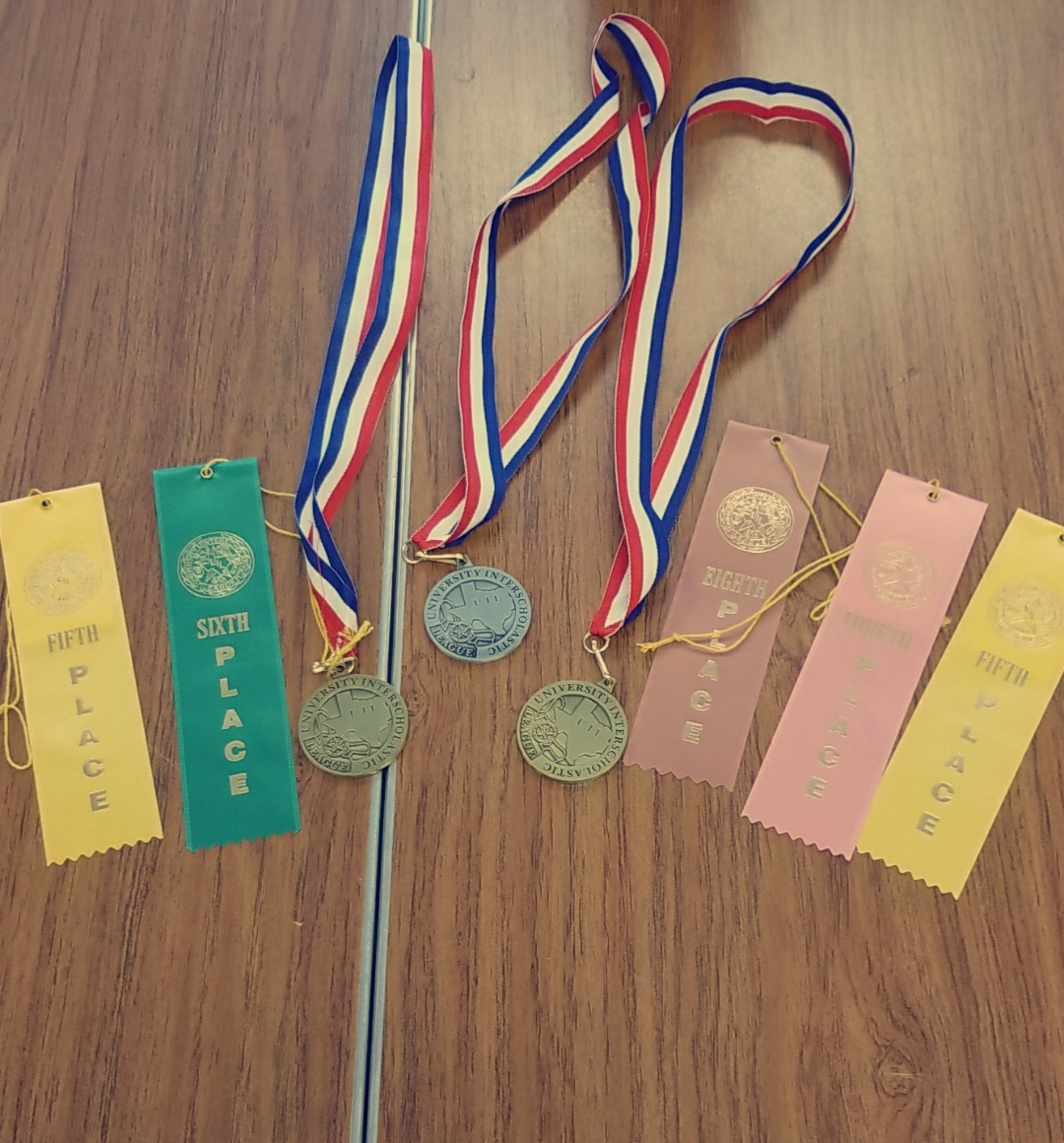 Students place in Journalism UIL Central Texas practice meet and receive medals and ribbons.