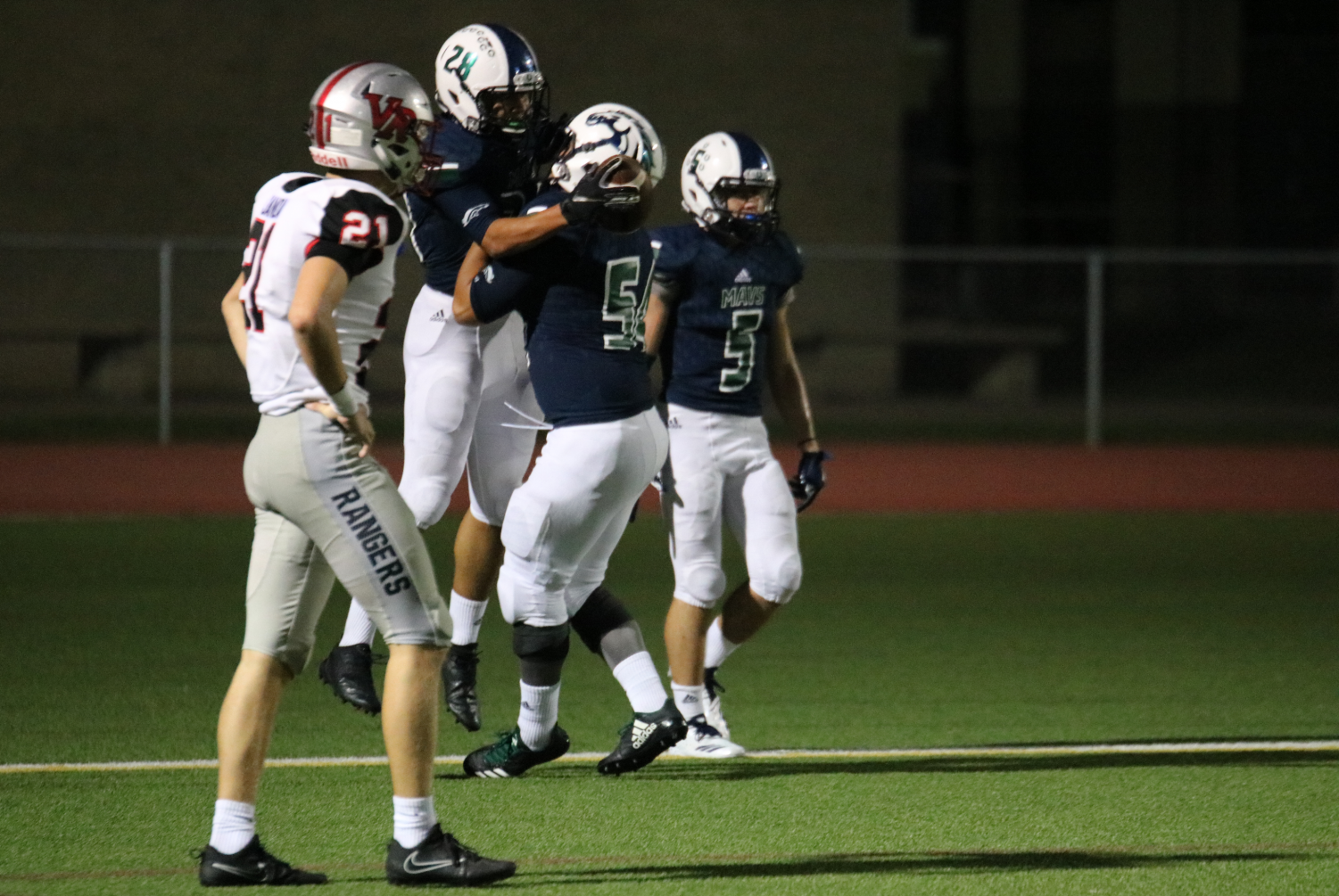 After punching in a touchdown, junior running back Winston Hutchison (#28) celebrates with senior offensive lineman Deinkhanh Tran (#54) in the endzone. The Mavs clinched their first district win over the Vista Ridge Rangers 49-21 at Dragon Stadium Sept. 14.