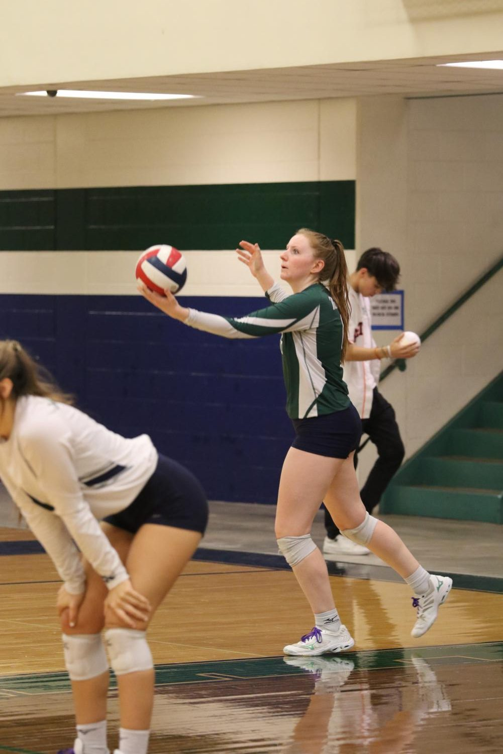 Senior Erin Flood Serves against Stony Point