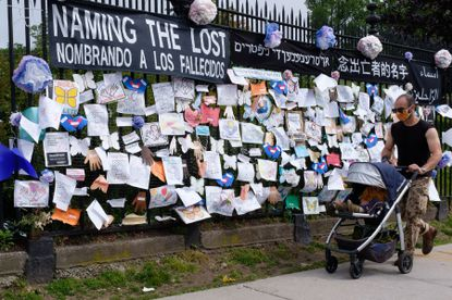 A memorial wall outside Green-Wood Cemetery in Brooklyn, New York pays tribute to Covid-19 victims on Thursday, May 28