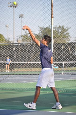 Senior Anuj Nigam practices for tennis season. Tennis has both a fall and spring season.