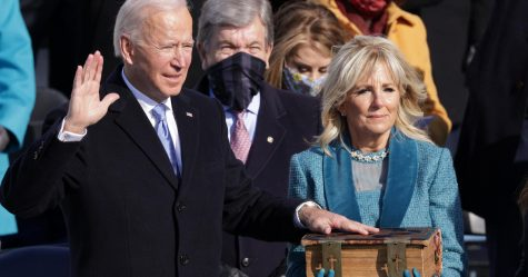 President Biden repeating the Oath of Office next to First Lady, Jill Biden.