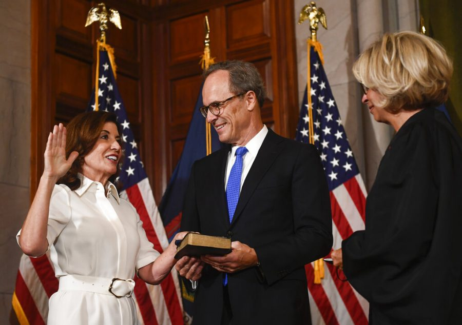 Governor Kathy Hochul reading the Oath of Office as she becomes New York's first female governor.