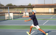 Shaunak Gadgil volleys at the service line against Hutto at the match on Thursday.