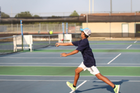 Shaunak Gadgil volleys at the service line against Hutto.